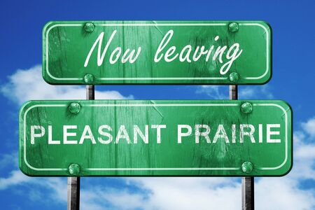 pleasant: Now leaving pleasant prairie road sign with blue sky