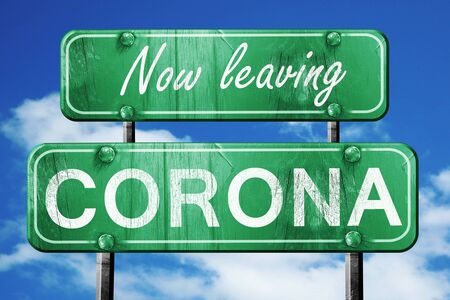 corona: Now leaving corona road sign with blue sky