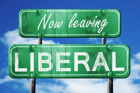 liberal: Now leaving liberal road sign with blue sky