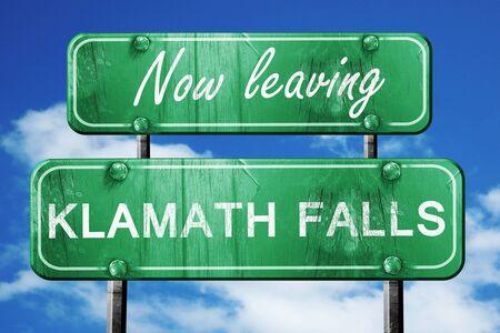klamath: Now leaving klamath falls road sign with blue sky Stock Photo