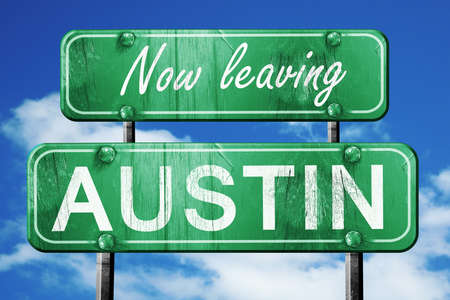 austin: Now leaving austin road sign with blue sky