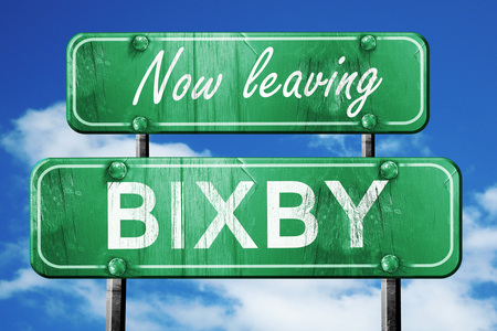 bixby: Now leaving bixby road sign with blue sky