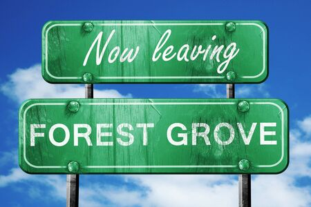 grove: Now leaving forest grove road sign with blue sky Stock Photo