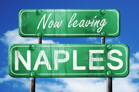 naples: Now leaving naples road sign with blue sky