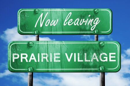 prairie: Now leaving prairie village road sign with blue sky Stock Photo