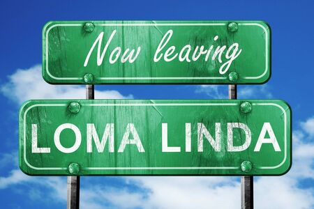 linda: Now leaving loma linda road sign with blue sky