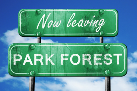 forest road: Now leaving park forest road sign with blue sky Stock Photo