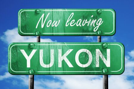 yukon: Now leaving yukon road sign with blue sky