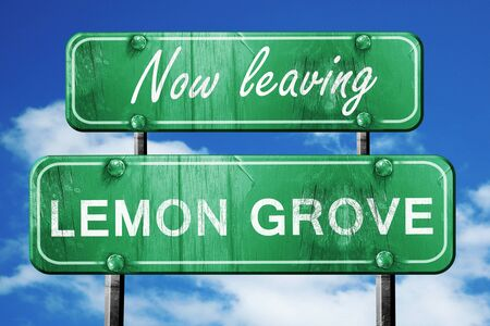 grove: Now leaving lemon grove road sign with blue sky Stock Photo
