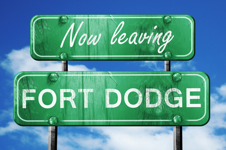 dodge: Now leaving fort dodge road sign with blue sky