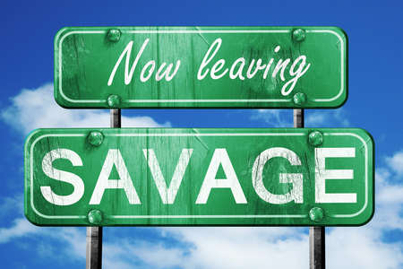 savage: Now leaving savage road sign with blue sky Stock Photo