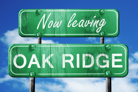 ridges: Now leaving oak ridge road sign with blue sky Stock Photo