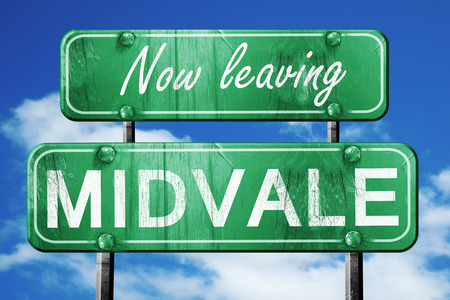 leaving: Now leaving midvale road sign with blue sky