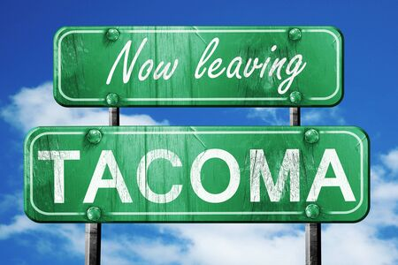 tacoma: Now leaving tacoma road sign with blue sky Stock Photo
