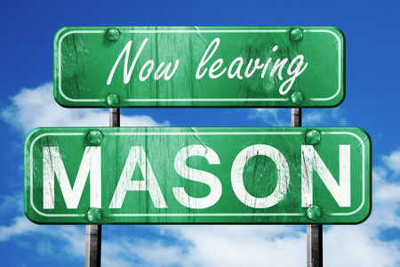mason: Now leaving mason road sign with blue sky