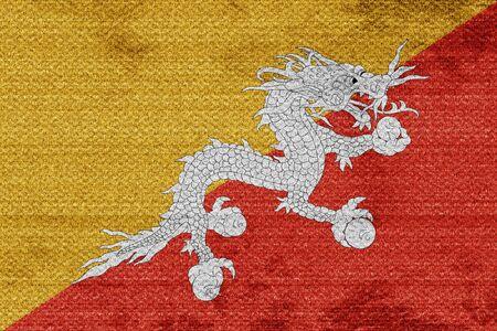 bhutan: Bhutan flag with some soft highlights and folds Stock Photo