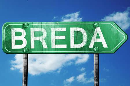breda: Breda road sign, on a blue sky background