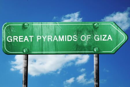 giza pyramids: great pyramids of giza road sign, on a blue sky background