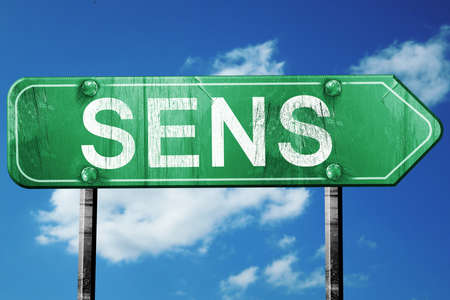 sens: sens road sign, on a blue sky background