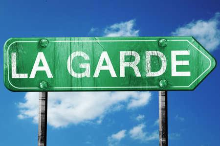 garde: la garde road sign, on a blue sky background