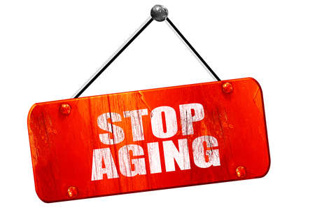 anti ageing: stop aging, 3D rendering, red grunge vintage sign