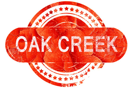 creek: oak creek, red grunge rubber stamp on white background