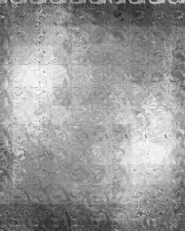 inox: Worn metal plate with reflected light