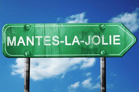 マント ・ ラ ・ ジョリー道路標識は、青空をバックに