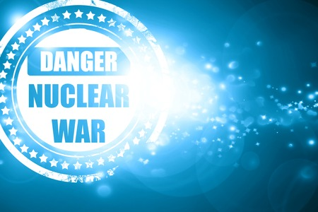 caution chemistry: Glittering blue stamp: Nuclear danger background on a grunge background Stock Photo