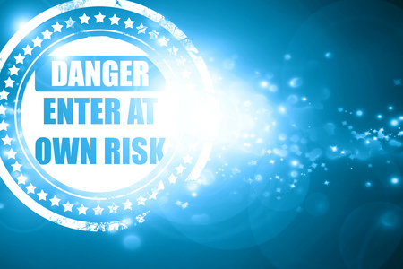 own: Glittering blue stamp: enter at own risk sign with some soft lines
