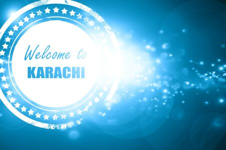 karachi: Glittering blue stamp: Welcome to karachi with some smooth lines