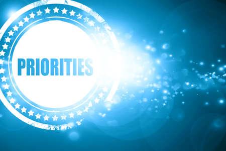 priorities: Glittering blue stamp: priorities Stock Photo