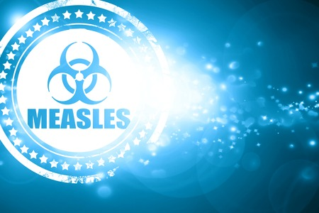measles: Glittering blue stamp: measles concept background with some soft smooth lines