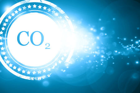 emission: Glittering blue stamp: CO2 warning sign with yellow and black colors Stock Photo