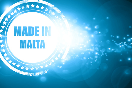 animal origin: Glittering blue stamp: Made in malta with some soft smooth lines Stock Photo