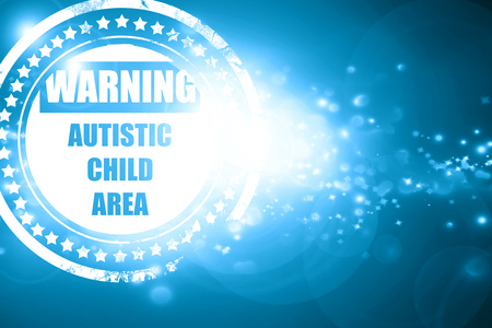 autistic: Glittering blue stamp: Autistic child sign with orange and black colors Stock Photo