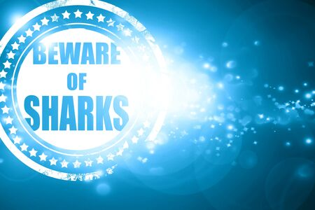 sighting: Glittering blue stamp: Beware of sharks sign with some smooth lines