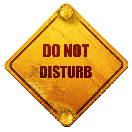 do not disturb sign: Do not disturb sign for a hotel room, 3D rendering, yellow road sign on a white background Stock Photo