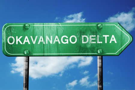 national park: Okavanago delta, 3D rendering, green grunge road sign