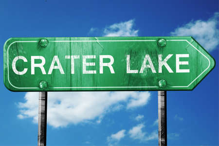 crater: Crater lake, 3D rendering, green grunge road sign Stock Photo