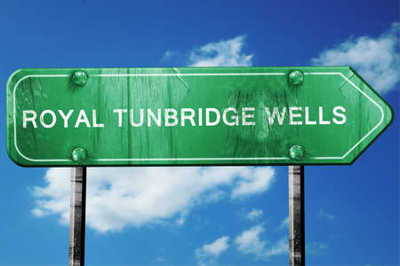 wells: Royal tunbridge wells, 3D rendering, green grunge road sign Stock Photo
