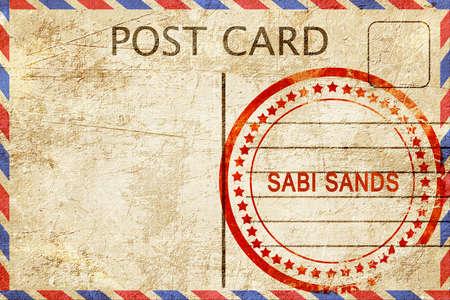 sabi: Sabi sands, a rubber stamp on a vintage postcard