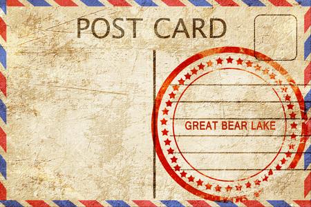 bear lake: Great bear lake, a rubber stamp on a vintage postcard Stock Photo