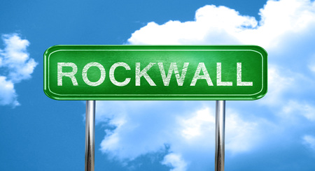 rockwall: rockwall city, green road sign on a blue background Stock Photo