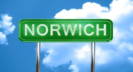 norwich city, green road sign on a blue background Stock Photo