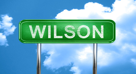 wilson: wilson city, green road sign on a blue background