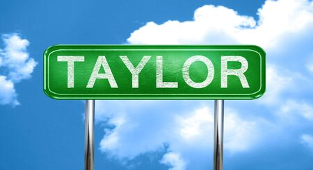 taylor: taylor city, green road sign on a blue background