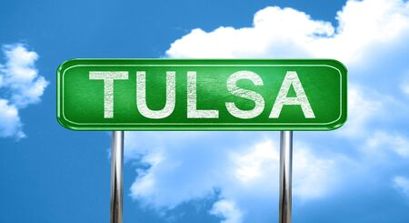 tulsa: tulsa city, green road sign on a blue background Stock Photo