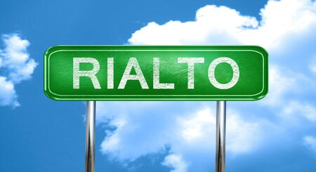 rialto: rialto city, green road sign on a blue background Stock Photo
