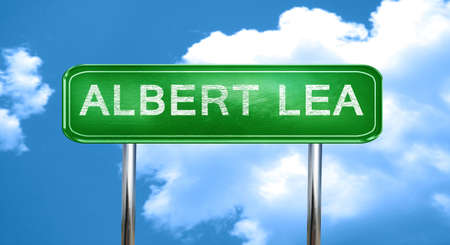 lea: albert lea city, green road sign on a blue background Stock Photo